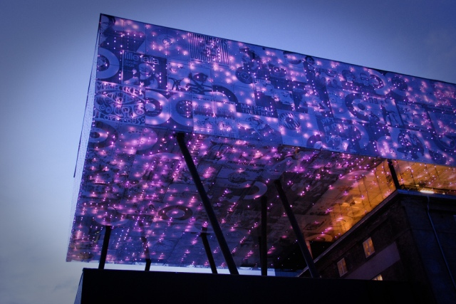 The Rockheim Museum in norway has a large illuminated feature which uses digital glass printing to great effect.